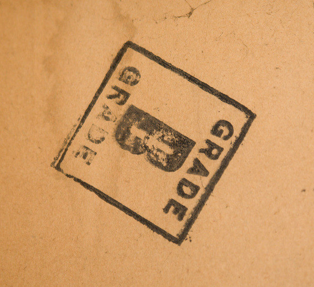 "A stamp on plywood stating ""Grade B"" in large block letters"