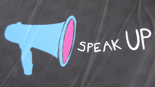 """an image of a megaphone with the words """"speak up"""""""