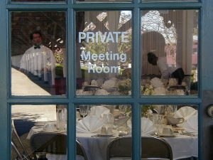 "A window printed with the words ""private meeting room"""